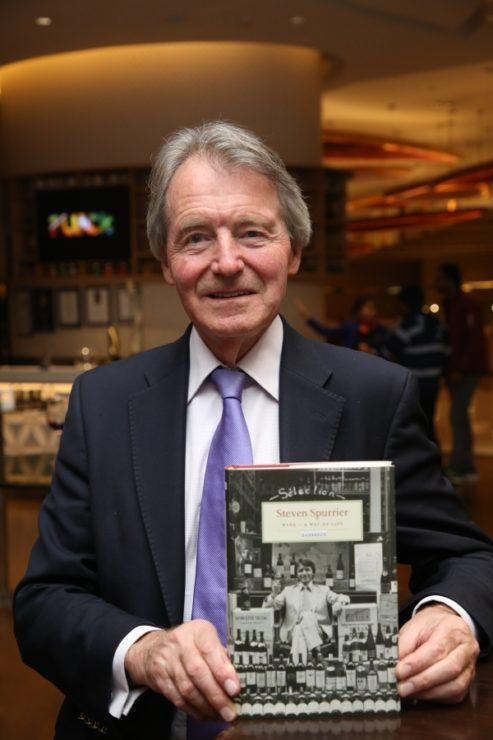 Steven Spurrier with a book